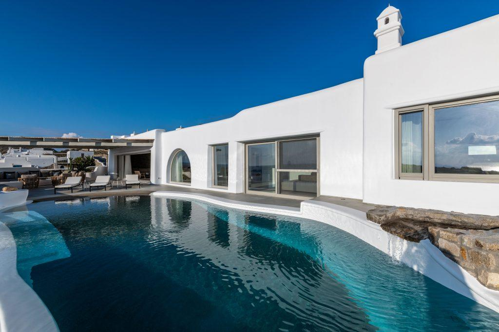 view of a modern villa with pool ideal place for summer