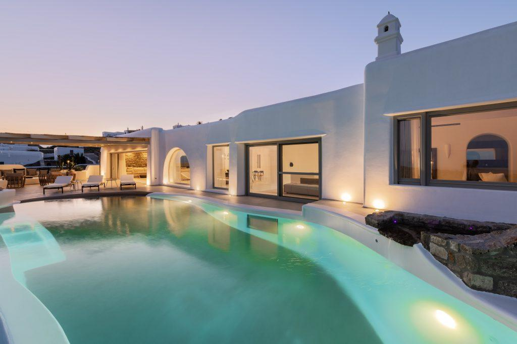 night view of the villa with lighted pool