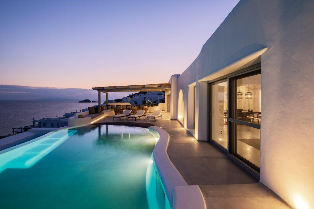 view of the beautiful sunset over the sea from the illuminated pool