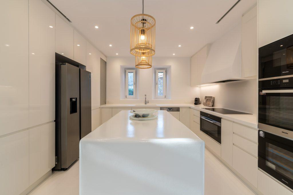 kitchen with large refrigerator and white modern elements of high gloss