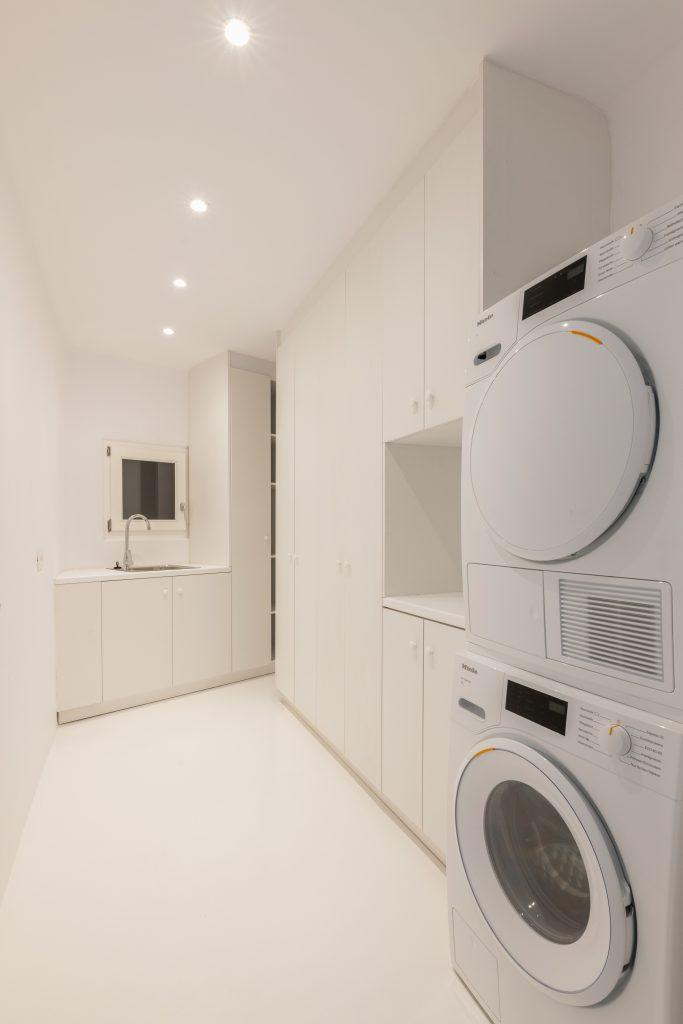 room equipped with modern appliances and a large white closet