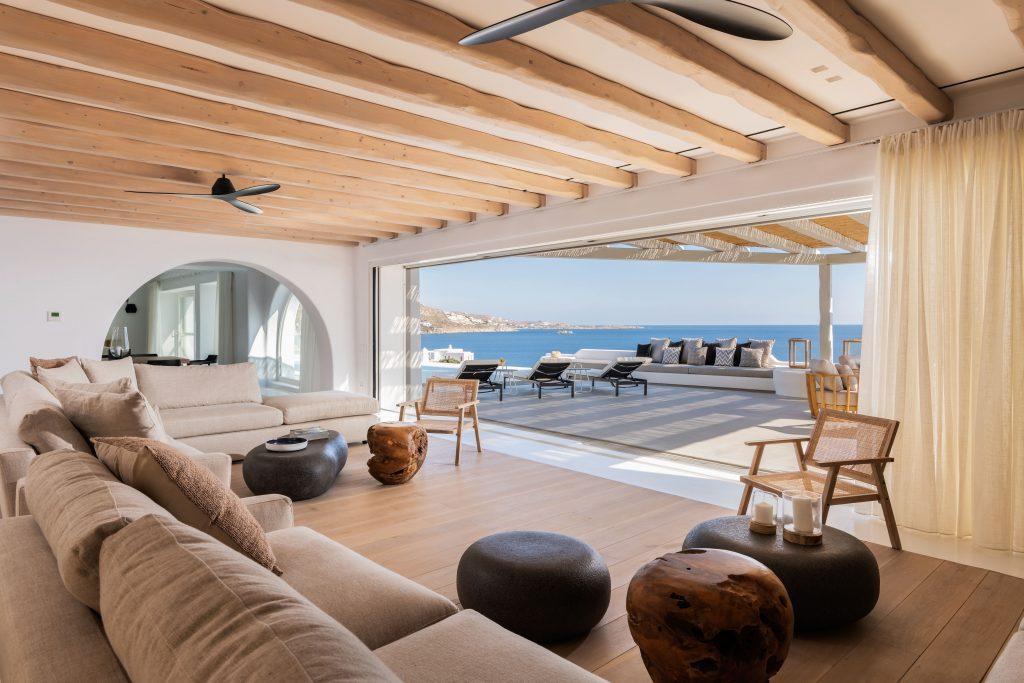 modern living room overlooking the blue sea and clear skies of Mykonos