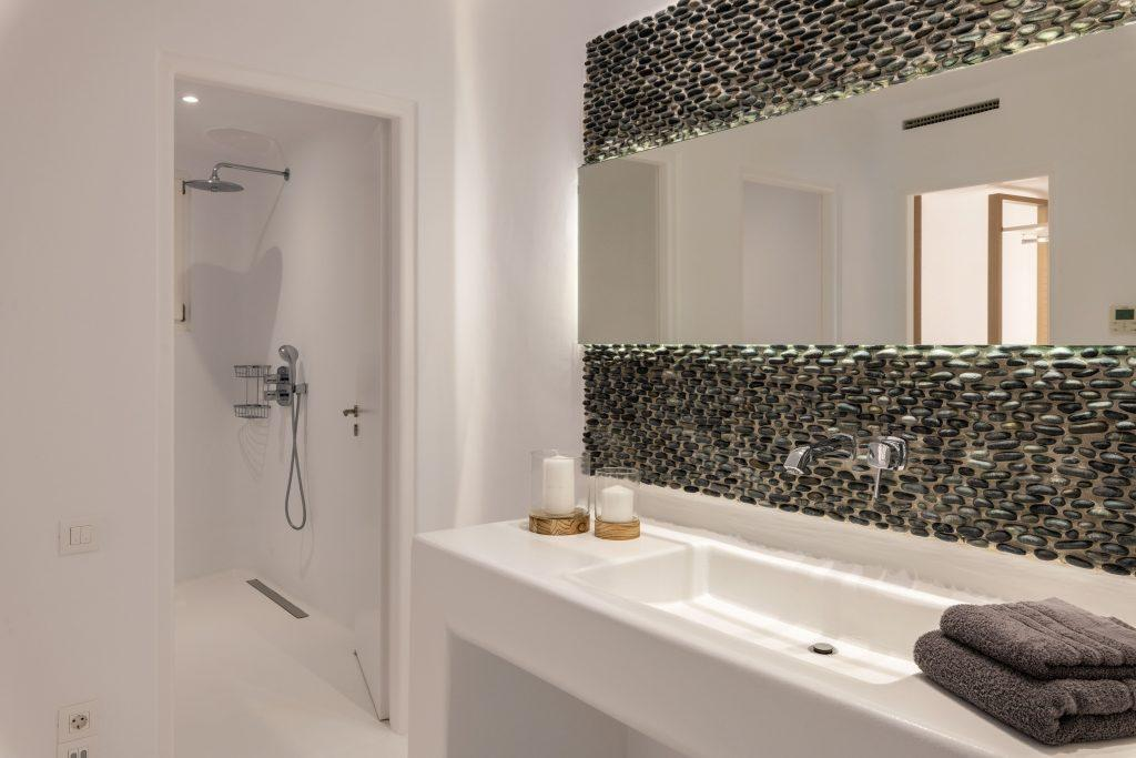 bathroom with shower and modern mirror