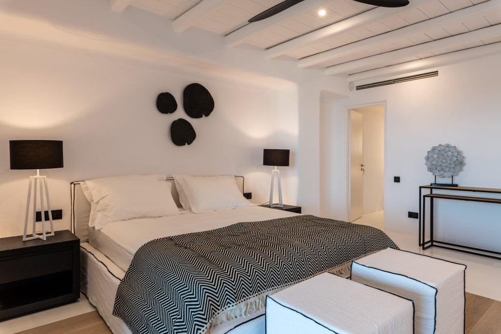 modern room for two with king size bed and decorative lamp in the corner