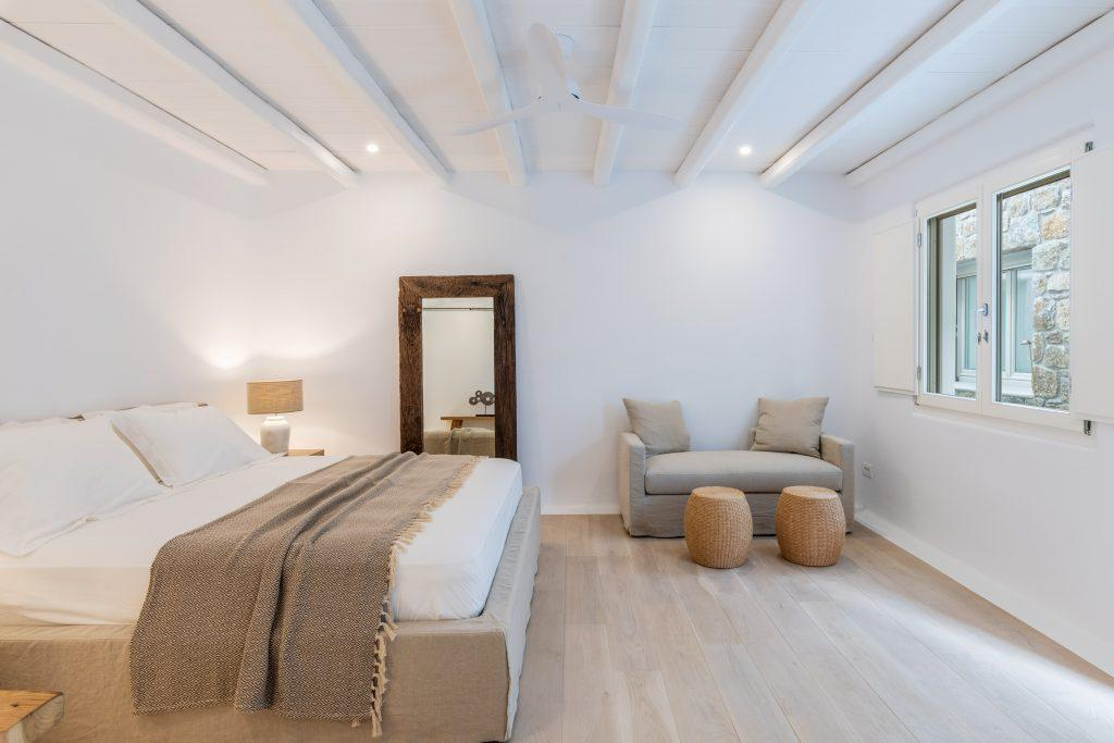 room for two with a comfortable bed and creamy furniture, decorated with roller tables
