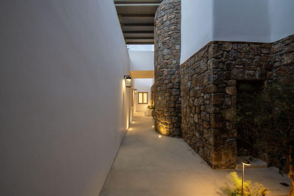 illuminated area with a mixture of stone and white walls