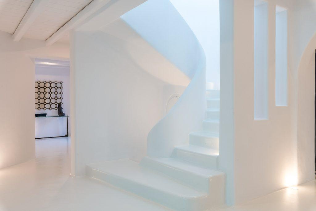 hallway with white walls and staircase