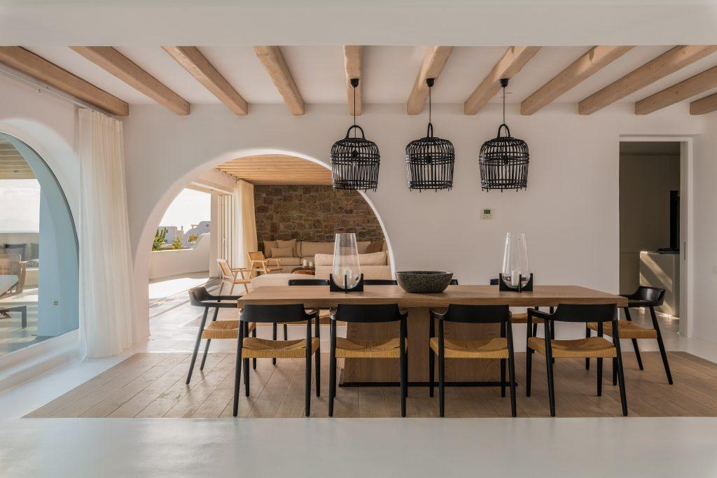 wooden dining table with modern chairs and decorative lamps