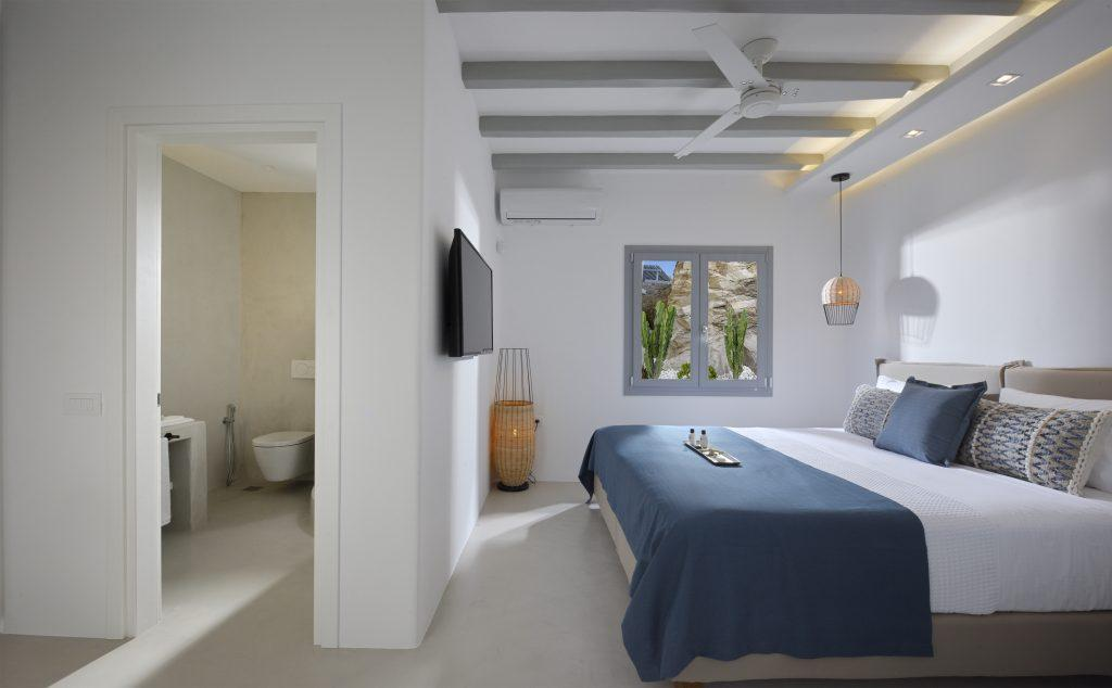 white walls of the room with king size bed and decorative lamps