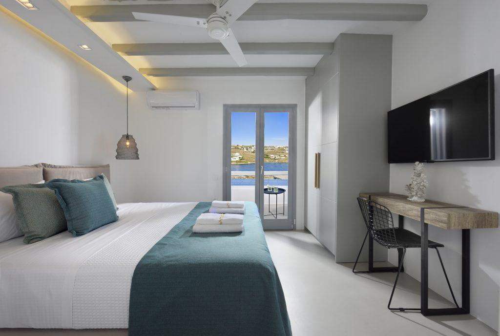 bedroom for two with a terrace door overlooking the blue sea and clear sky ideal for enjoyment