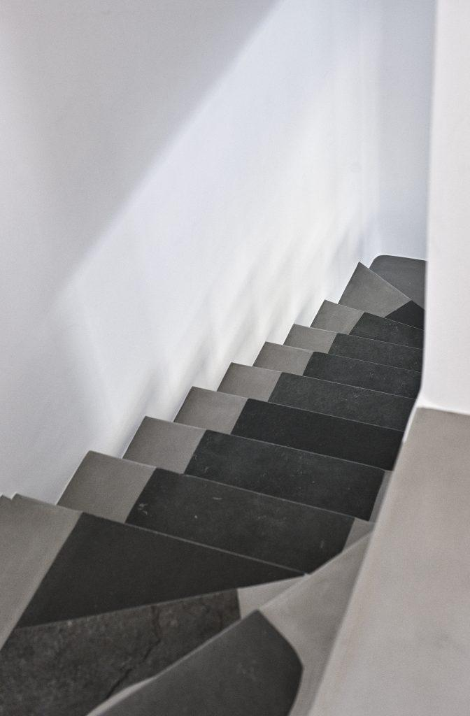 hallway of white walls with steps