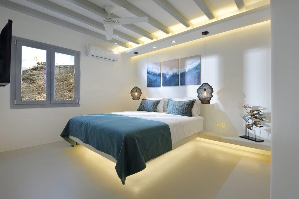 bedroom with dimly lit comfortable bed ideal for two