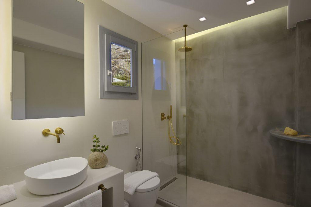 bathroom with large glass shower and white circular sink