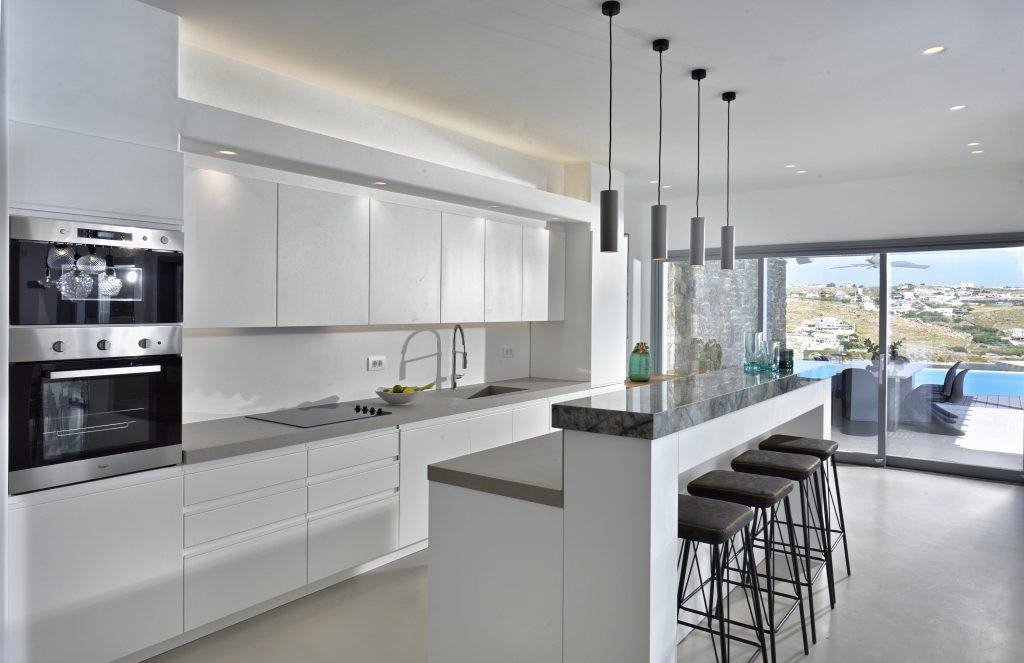 kitchen with white high-gloss elements and modern appliances