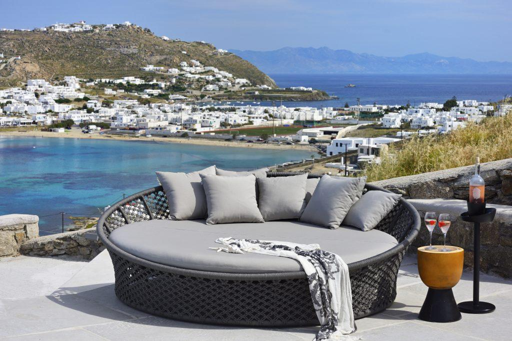 circular large deck chair for two with comfortable pillows ideal for enjoying and sunbathing