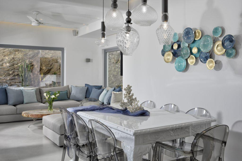 luxurious white dining table with modern chairs