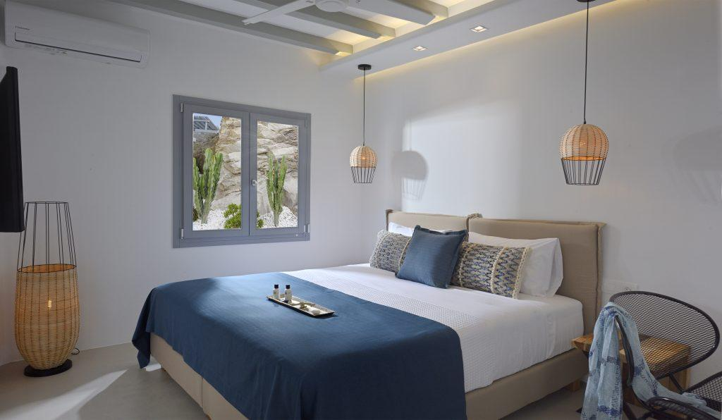 bedroom with cozy king size bed and modern decorative lamps