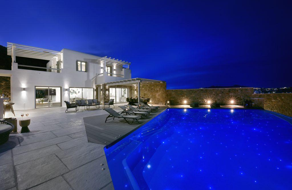 night view of the luxury villa dimly lit by a spacious courtyard