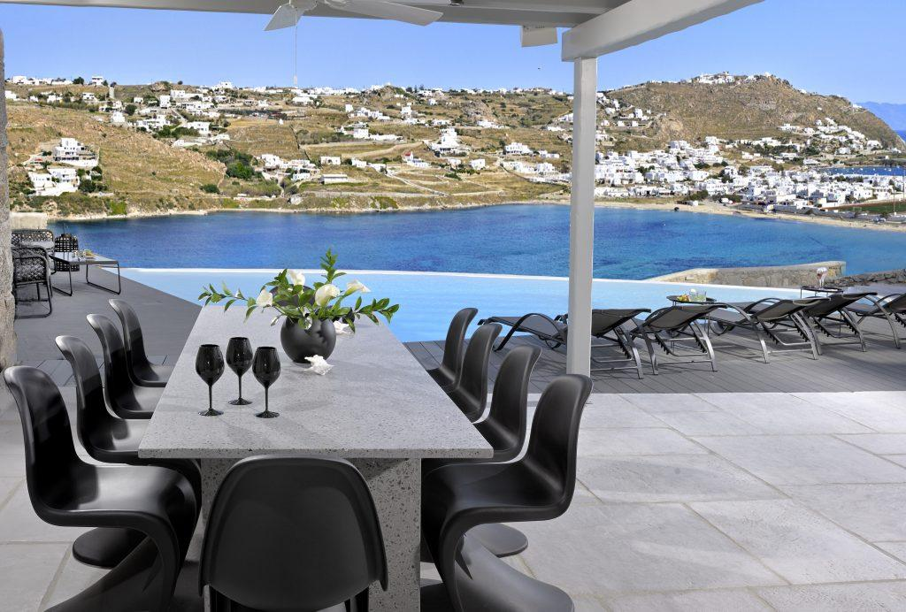 gray table with black chairs ideal for lunch with friends outdoors