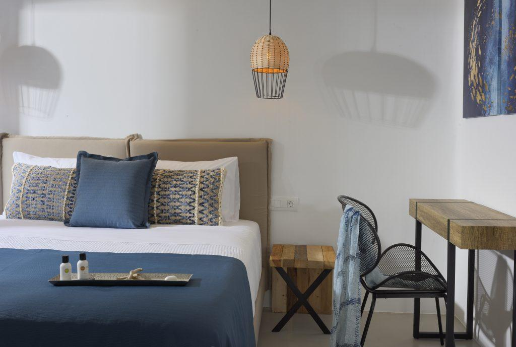 ideal room for two with white walls and blue linens