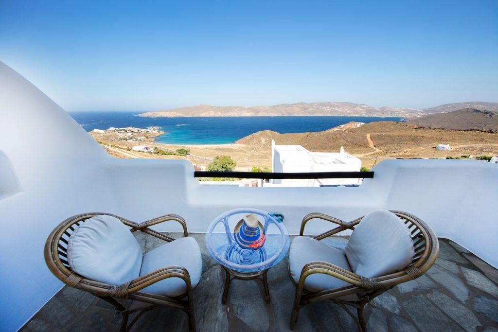 view of the extremely blue sea from the balcony for two to enjoy