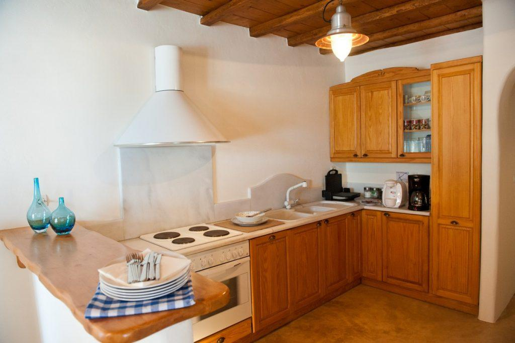 traditionally designed kitchen with wooden elements and a bar