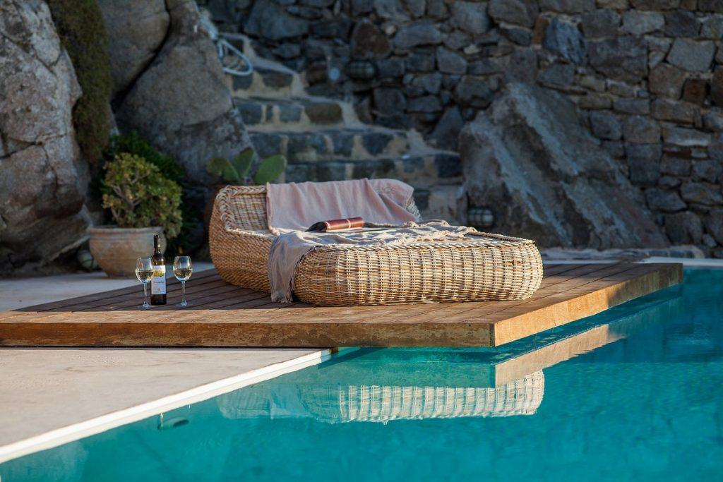 comfortable knitted sunbed to lay down and enjoy over champagne with your partner