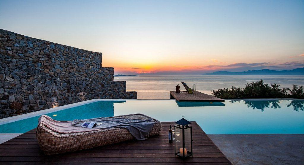 lay down and watch a sunset over a glass of wine