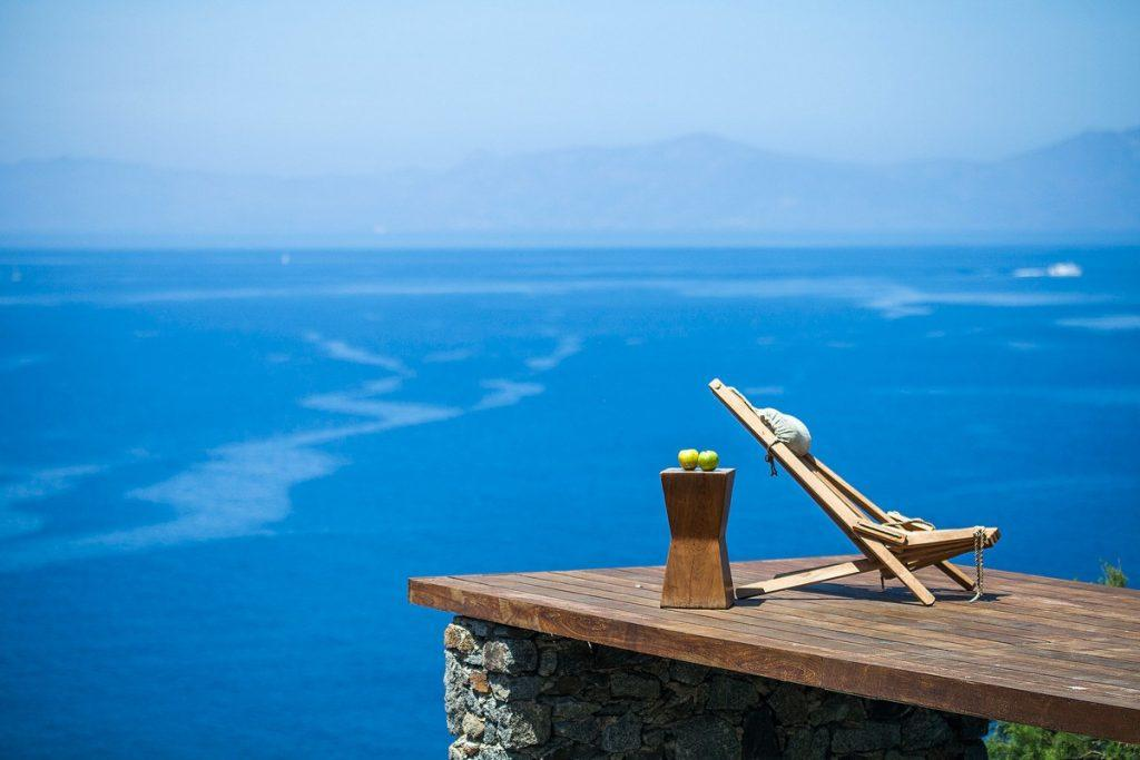 right to the sea wooden platform with easy chair for you the drink your favorite beverage and enjoy breeze of fresh air