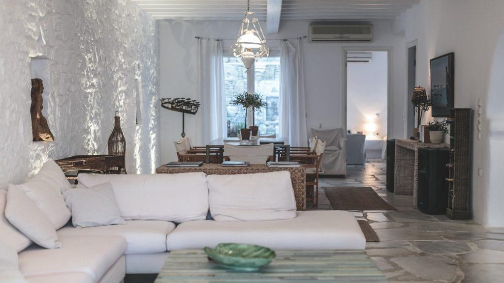 room with comfortable furniture and soft white pillows ideal for relaxing after a hard day
