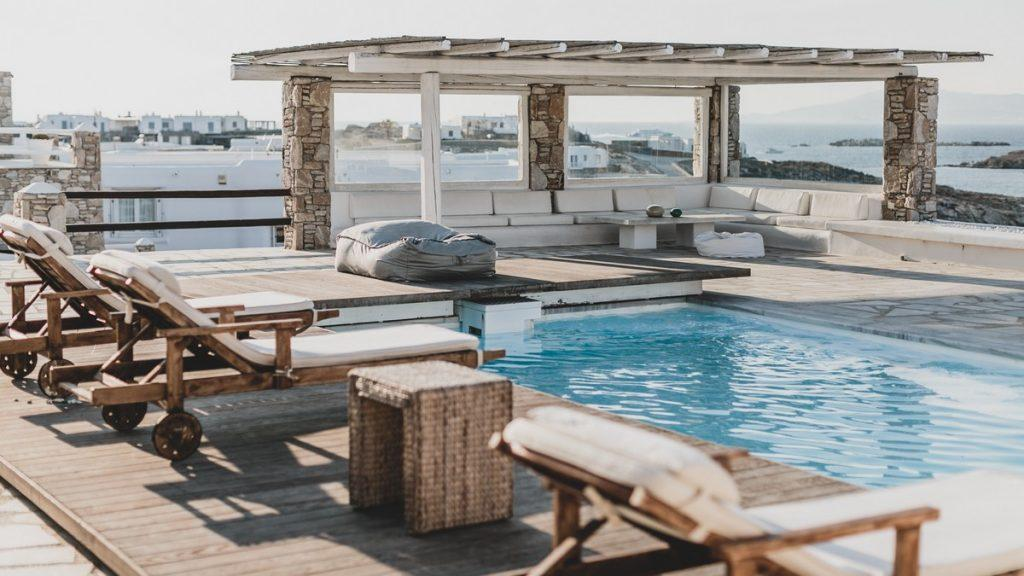 comfortable sun loungers by the pool for sunbathing and relaxing