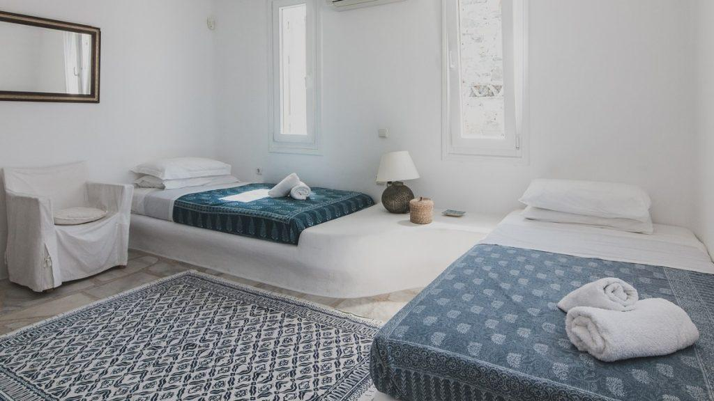 room with two comfortable beds ideal for rest and sleep