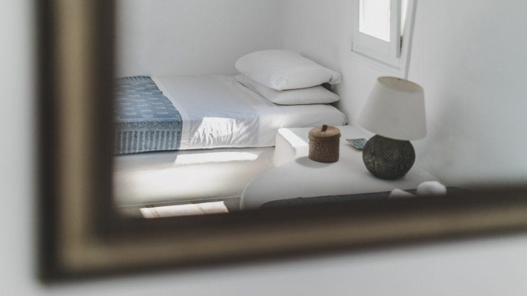 room with a comfortable bed and a decorative lamp ideal for sleeping