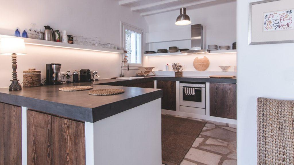 kitchen with wooden elements and modern appliances for preparing delicious meals
