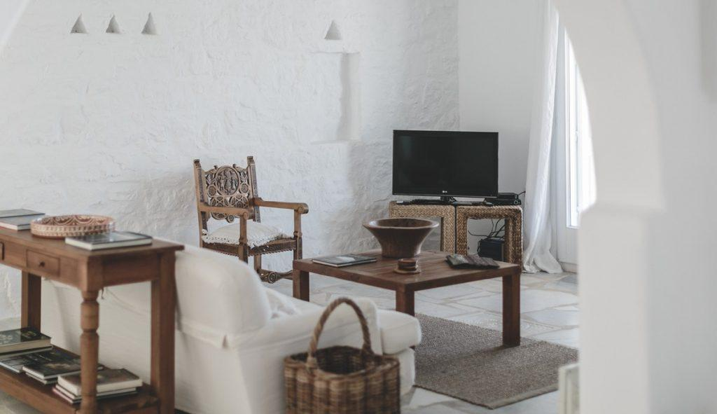 living room with white walls and wooden table ideal for enjoying afternoon coffee
