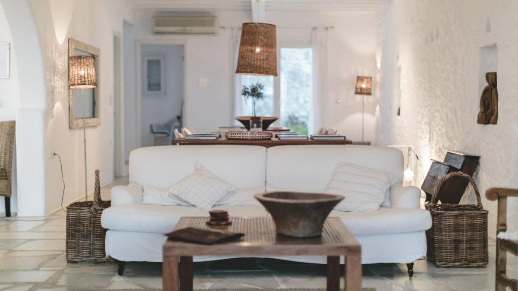 living room with decorative lamps and a cozy white sofa