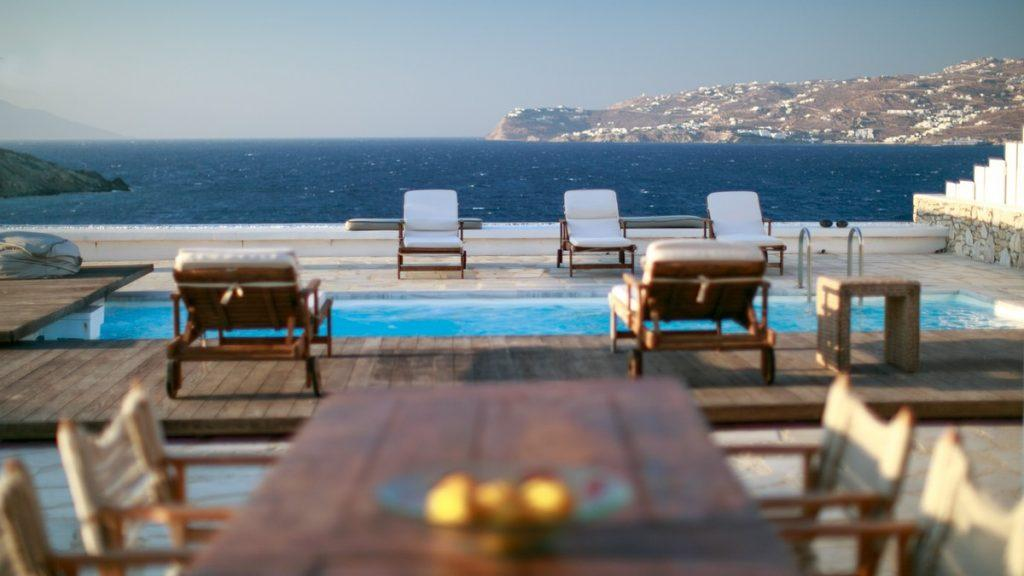 ideal place for sunbathing on the deck chairs by the pool of pleasant water