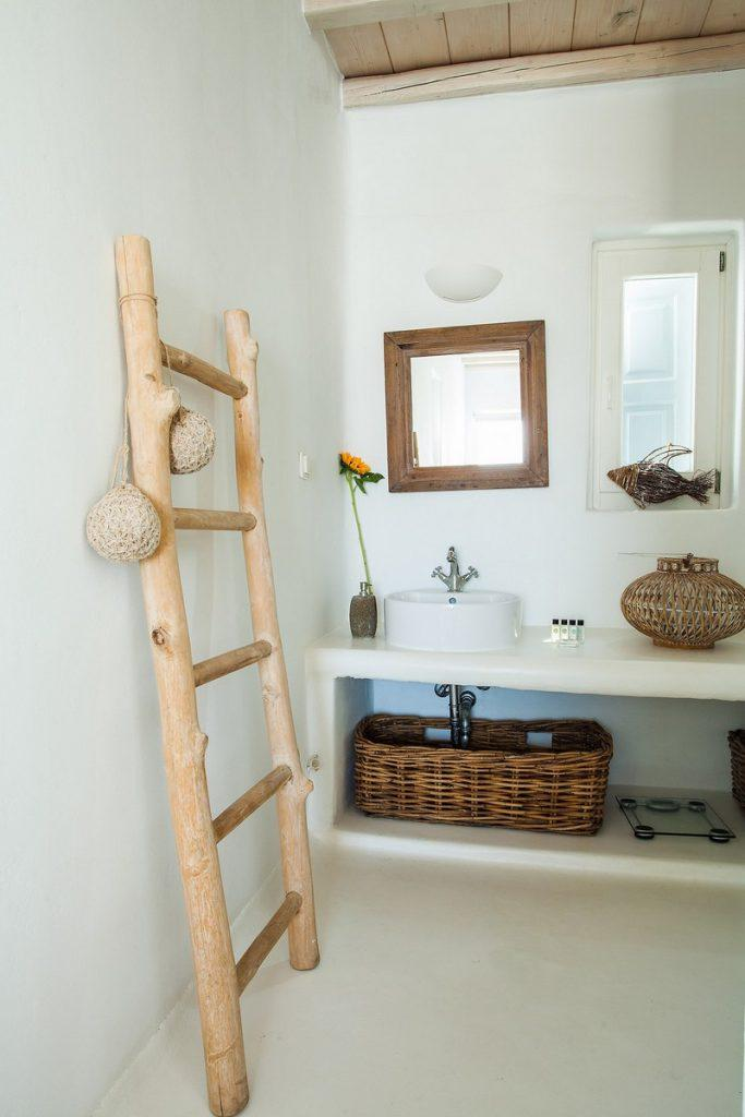 mirror and a white sink decorated with yellow flowers