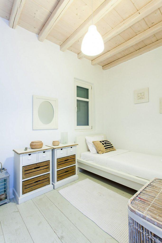 bedroom with a comfortable bed ideal for relaxing and wooden shelves