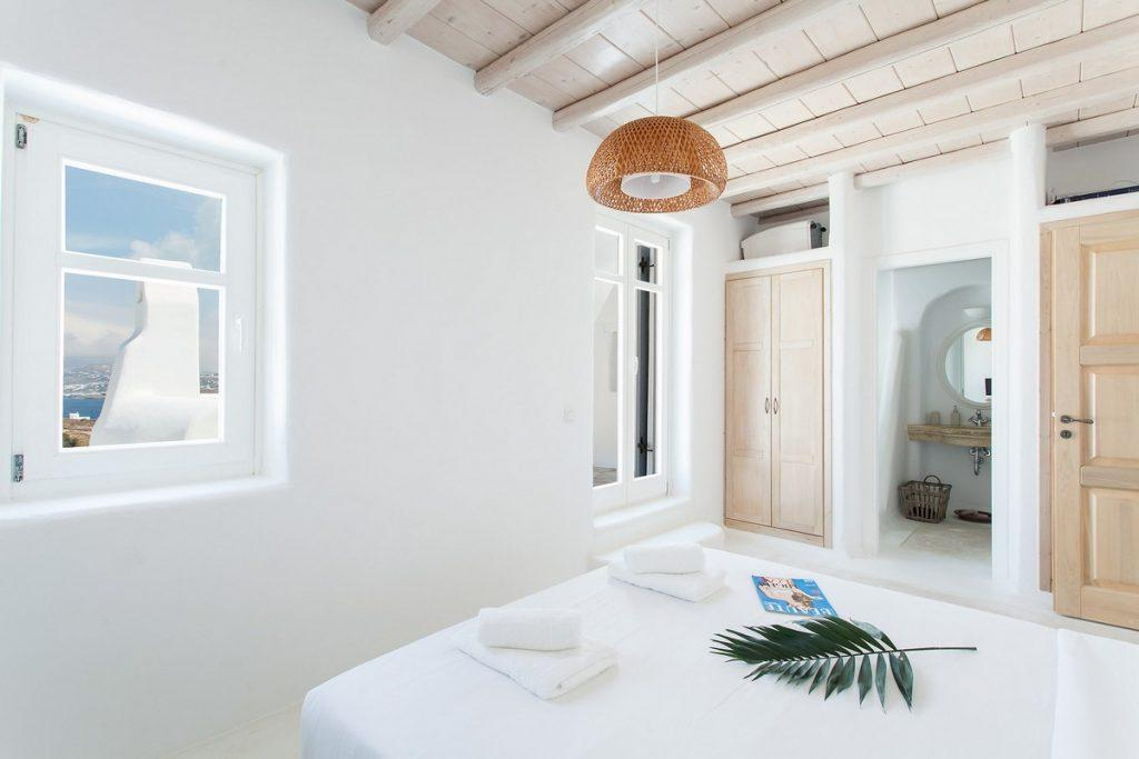 room with a comfortable bed and a large wooden closet ideal for two