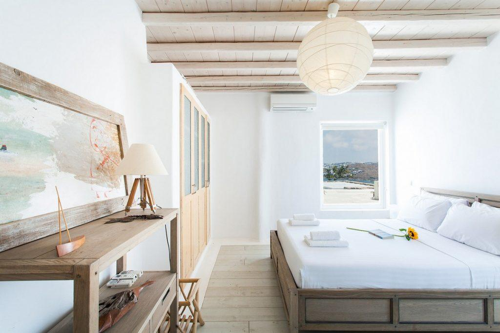 white walls of bedroom with decorative painting and wooden details