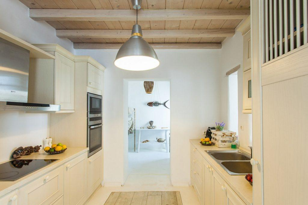 kitchen with modern appliances and wooden elements