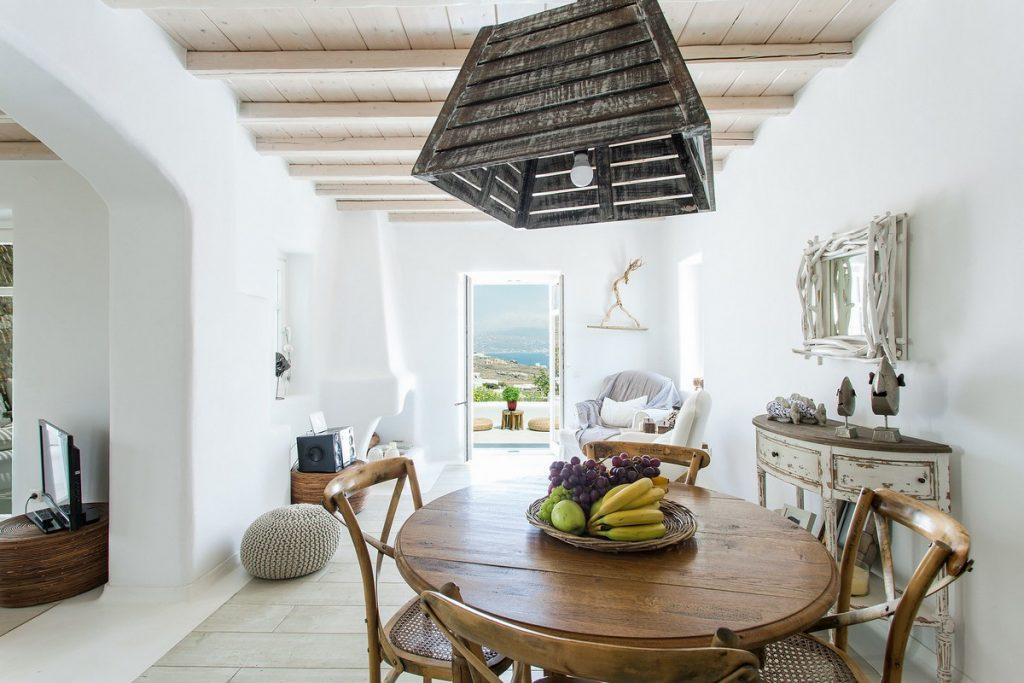 dining room with lots of daylight decorated with wooden details