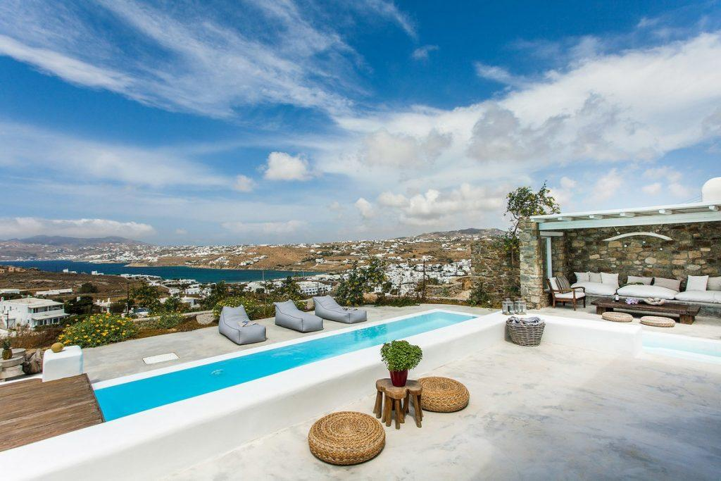 ideal place to enjoy by the pool in a beautiful view of the blue calm sea