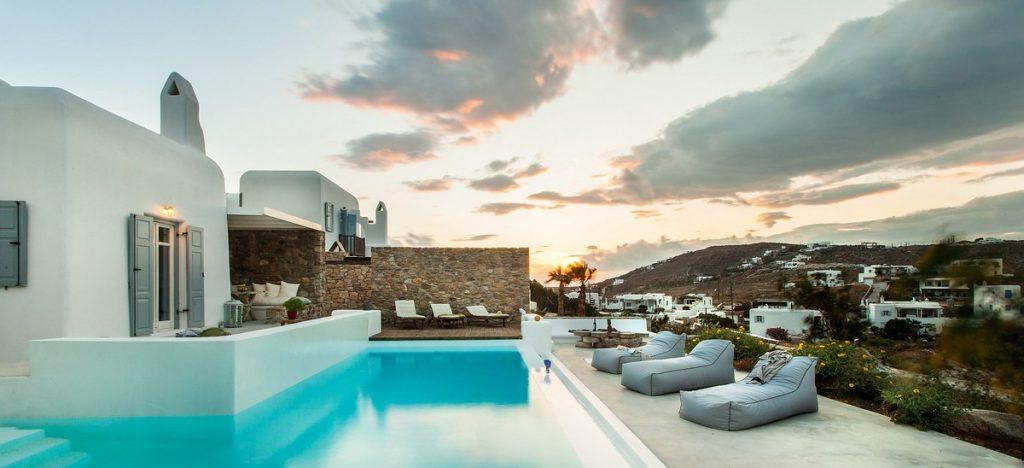 ideal place to enjoy the sunset on the soft sun loungers by the pool with the summer breeze