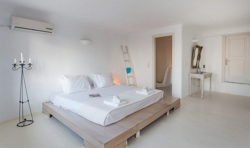 room in white tone with wooden decorative table and mirror