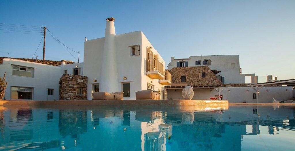 villa with a pool of pleasant water and large soft pillows ideal for sunbathing