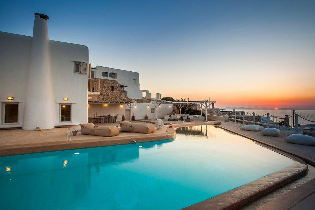 view of the villa with an enchanting view of the sunset over the blue calm sea