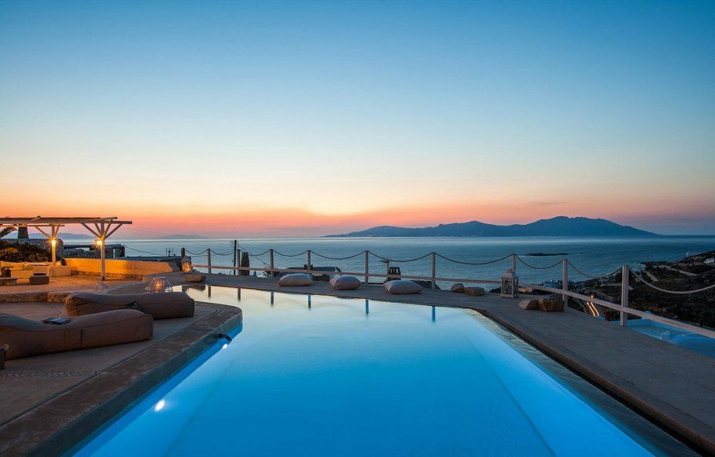 fascinating view of the sunset from an endless pool of pleasant water