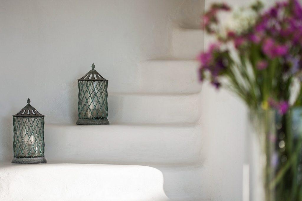 white walls of the villa with decorative lanterns and flowers